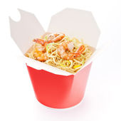 Noodles with shrimp in take-out box on white background — Stock Photo