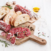 Italian salami on wooden cutting Board — Stock Photo