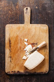 Parmesan cheese on wooden cutting Board — Stock Photo