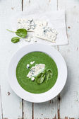 Spinach soup with cheese in white bowl — Stock Photo