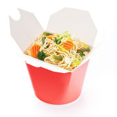 Noodles with vegetables in take-out box on white background — Stock Photo