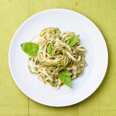 Spaghetti with basil — Stock Photo