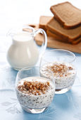 Boiled buckwheat with milk in glass — Stock Photo