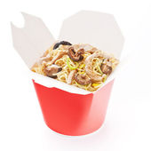 Noodles with pork and shiitake mushrooms in take-out box on whit — Stock Photo
