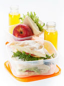 Lunch box with sandwich apple and juice — Stock Photo