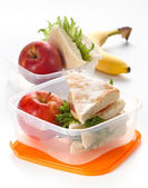 Lunch box with sandwich and apple — Stock Photo