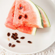 Watermelon slices on white plate - Stock Photo