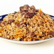 Uzbek national dish pilaf on plate — Stock Photo #24535395