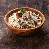 Wild mushrooms risotto with parsley and parmesan — Stock Photo