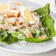 Caesar salad with eggs and chicken breast — Stock Photo