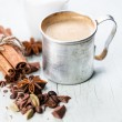 Coffee in aluminum mug with spices - Stock Photo