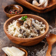 Wild mushrooms risotto with parsley and parmesan - Stock Photo