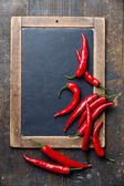 Red Hot Chili Peppers on vintage slate chalk board — Stock Photo