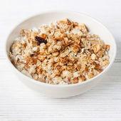 Muesli granola with raisin in wooden bowl — Stock Photo