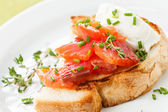 Bruschetta with soft cheese and smoked salmon — Stock Photo