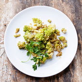 Steamed Cauliflower Romanesco on white plate — Stock Photo