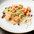 Spaghetti with prawns, sea scallops and parmesan — Stock Photo #28964913