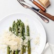 Stock Photo: Asparagus with Parmescheese on white background
