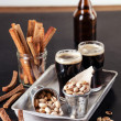 Dark beer and snack to beer — Stock Photo