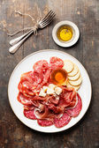 Platter of Assorted Snack ham, salami, cheese and honey — Stock Photo