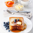 French toast with blueberries, maple syrup and butter — Stock Photo #30196765