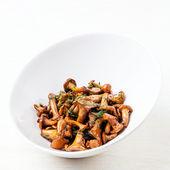 Fried wild mushrooms in white bowl — Stock Photo