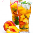 Glass of fruit iced peach Mojito cocktail with mint — Stock Photo #30796257