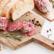 Italian salami with bread on wooden cutting Board — Stock Photo