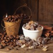 Coffee beans in bucket, cinnamon and brown sugar — Stock Photo