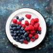 Raspberries and bilberries — Stock Photo