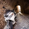 Moped on narrow street — Foto Stock