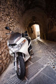Moped on narrow street — Stock Photo