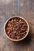 Coffee beans in ceramic bowl — Stock Photo