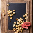 Vintage chalk board with popcorn — Stock Photo