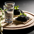 Vodka and black caviar — Stock Photo