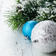 Christmas decoration with balls and fir branch — Stock Photo