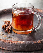 Hot tea with milk and spices — Stock Photo