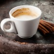 Coffee cup with  cinnamon sticks  — Stock Photo