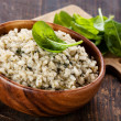 Risotto with spinach in wooden bowl — Foto Stock