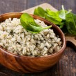Risotto with spinach in wooden bowl — Stock Photo