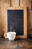 Coffee cup and Vintage slate chalk board — Stock Photo