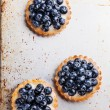 Three blueberry tarts — Stock Photo