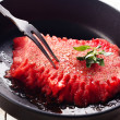 Watermelon slice on black pan — Stock Photo