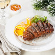 Roasted Duck Breast on New Year's festive table — Stock Photo #36983345