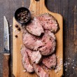 Roast beef on cutting board — Stock Photo #38573191