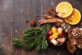 Cup of hot wine with spices — Stock Photo