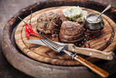 Beef steak filet mignon and butter with herbs — Stock Photo