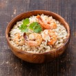 Stock Photo: Shrimps Risotto in wooden bowl