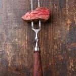 Beef steak on meat fork — Stock Photo #41615103