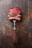 Slices of beef steak on fork — Stock Photo